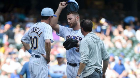 Brewers pitcher vomits twice, finishes inning